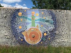 Mosaic wall by the artist who lives behind it - in Gimios, on the road toward our house