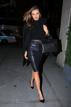 Need another reminder that black leather isn't all tough? Miranda put a supersexy spin on it, wearing a pencil skirt with black pumps and a high-neck top.