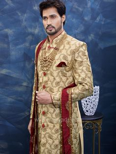 Miraculous golden color art silk fabric sherwani glamorized with zari, resham, zardozi, cutdana and stone work is representing a royalty in itself. Make your day most memorable and lovable with this ensemble. Indian Groom Wear, Wedding Sherwani, Marriage Dress, Groom Poses, Indian Man, Groom Outfit, Color Art, Stone Work, Golden Color