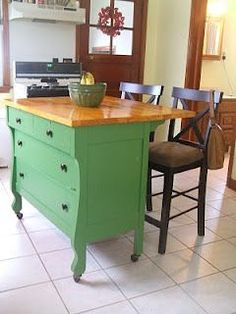 What a great, easy idea for a rustic kitchen island! A dresser with a new wood top & a couple chairs! Would be SO cute in an antique white!