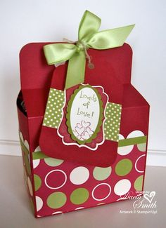"Creative Tips: 1.The cookie box holds eight homemade chocolate chip cookies in a Large Cello Bag tied with a yummy Old Olive Striped Grosgrain Ribbon bow. 2. Just punch several 3/4"" circles to slip..."