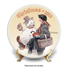 Official 2012 Edition Norman Rockwell Annual Christmas Plate.  2012 Christmas collector plate faithfully recreates Norman Rockwell's classic 1919 holiday painting on Heirloom Porcelain®. Limited edition.