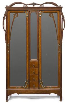 Art Nouveau Carved Walnut and Brass Armoire / circa 1900