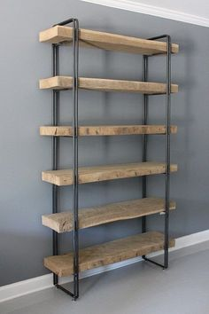 Reclaimed Wood Shelf / Shelving Unit - FREE Shipping - Lifetime Warranty This listing is for a handmade reclaimed wood shelving unit supported by a modern round bar steel frame. The wood is 3 Old Growth (160+ Years old) Reclaimed White Oak. We also include a free set of coasters with every order! Shown in photo 5. The overall dimensions of the unit in the photo are 84H x 48W x 12W. Each shelf is a single plank of 3 reclaimed white oak. Other sizes are available in the drop down menu…