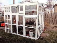 Garden greenhouse made by recycling old windows. I would love to make this when we finally upgrade our windows. It would be a great use for them!