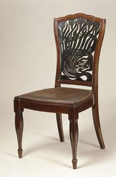 Pre Art Nouveau chair designed by Arthur Heygate Macmurdo in 1882. Mackmurdo traveled with Ruskin in Italy and worked with William Morris
