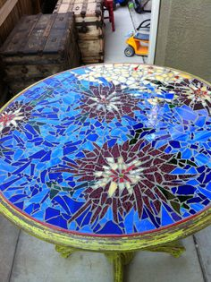 I have always wanted to do a mosaic something.... This is my first table...