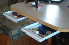 RV and travel trailer storage and organization solution - drawers under table