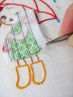 bunny with brolly embroidery - removing waste canvas with tweezers by Joey's Dream Garden, via Flickr