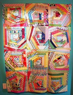 what a fun scrap buster!   I LOVE what the maker of this quilt has to say...  I know the scrap vomit thing going on here isn't for everyone - but for me, these fabrics are a reminder of lots of the projects I've done in the past