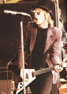 Tom Petty in a top hat given to him by a fan. 1978.