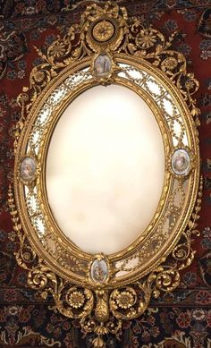 59cbefa694587 A Victorian giltwood and gilt composition mirror