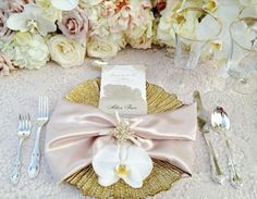 ShaFox.com A single bloom and jeweled napkin ring ornament this charger plate beautifully at this gold and blush wedding