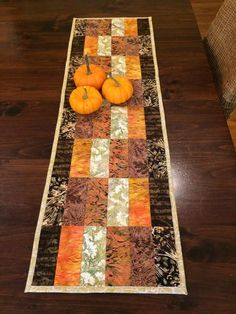Modern quilted batik table runner in orange, brown, green and mustard yellow Sie Herbst Tischläufer Quilted Table Runners Christmas, Patchwork Table Runner, Halloween Table Runners, Table Runner And Placemats, Table Runner Pattern, Quilt Table Runners, Fall Table Runner, Bed Runner, Table Topper Patterns