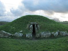 Bryn Celli Ddu on Anglesey is one of the finest Late Neolithic passage graves in Wales and is aligned to the midsummer sunrise. Inside is an unusual upright stone, carved with spirals which now resides in National Museum Wales in Cardiff.