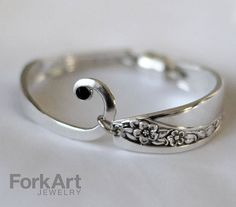 Handcrafted from an antique silverplate fork, this bracelet fits nicely on a wrist size of approximately 6 in diameter. Includes a magnetic clasp*