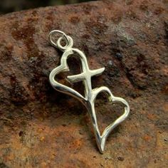 This would be a great idea for a tattoo........Hearts connected by the cross symbolize the bond we have through Christ to others. Top of side above name heart chain.