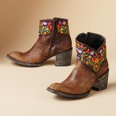 """MINI SORA BOOTS BY OLD GRINGO--Old Gringo crowns mellowed brown boots with a lavish collar of embroidered flowers. Entirely handmade, with an inside zipper, leather lining and sole. Imported. Whole and half sizes 6 to 10, 11. 2-1/2"""" heel.View our entire Old Gringo Collection."""