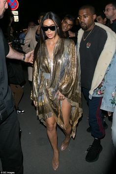 Enough: The source said that Kim, pictured in Paris just prior to the armed robbery, is growing weary of the situation