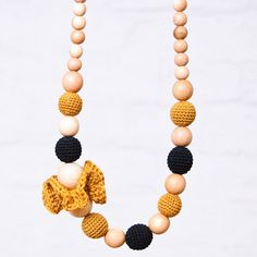 Beaded Nursing Necklace :: so cool! perfect for moms of nursing or teething babes. Made from totally natural materials (wood and cotton), this necklace is meant to stimulate your baby's mind with a contrasting color combination and blend of textures. would make an awesome gift for a soon-to-be mom. ::or if i ever have another::
