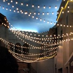 "I love that these lights aren't just straight across. I'd like for the lights to be criss-crossed and slanted, not all parallel to each other. The criss-crossing and slanted nature makes it feel more free and more ""cute little Italian restaurant in the alley way"""