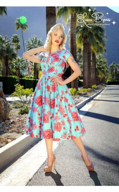 Jessy is enamoured with these dresses, I like this one the best! Pinup Couture - Evelyn Dress in Baby Blue with Pink Roses | Pinup Girl Clothing