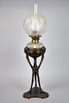 century bronze Empire style oil lamp, with original shade… - Lamps - Kerosene - Lighting - Carter's Price Guide to Antiques and Collectables Victorian Lighting, Victorian Lamps, Antique Lighting, Antique Oil Lamps, Vintage Lamps, Vintage Bottles, Antique Bottles, Vintage Perfume, Hurricane Oil Lamps