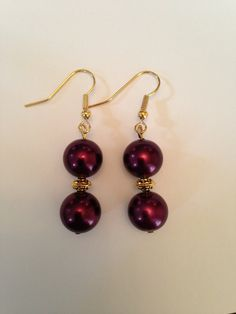 this color is to die!!      Burgundy purple colored pearl bead and gold accent drop earrings. $10.00, via Etsy.