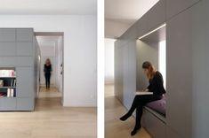 Rénovation d'un appartement contemporain à Lyon avec un meuble central sur mesure. Meuble d'entrée avec alcôve.