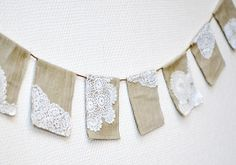 This banner is made out of fabric and crochet doilies - I have made look-a-like from paper bags and paper doilies.