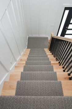 Gray patterned carpet runner on wood stairs. Patterned Carpet, Grey Carpet, Carpet Staircase, Wood Stairs, Grey Pattern, Staircases, Carpet Runner, Family Room, This Is Us