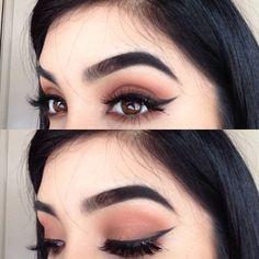 dramatic eyebrows, flawless cat eye and eyeshadow. beautiful.