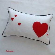 Handmade stencilled heart cushion. I love sewing and craft.