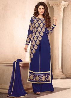 This blue faux georgette designer suit is adding the appealing glamorous displaying the sense of cute and graceful. The enticing embroidered and resham work a substantial attribute of this attire. Com...