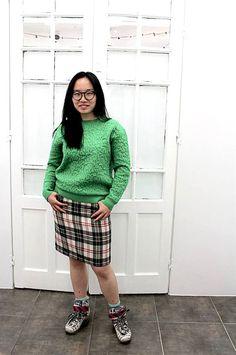 Happy with her tartan skirt