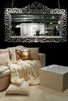metal mirror and white coach