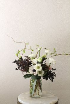 Privet and anemone arrangement by Sarah Winward.
