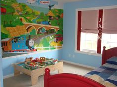 Thomas the train room! Blue walls, red accents.