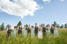 Bridal party (groomsmen and bridesmaids) in elegant formal pose with bride and groom for bridal party pic in a field. Wedding at Spruce Mountain Ranch in Larkspur Colorado Ryan loves Corie Photos by Katie Corinne Photography