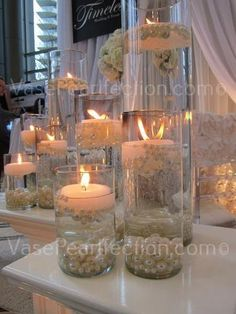 Elegant DIY Pearl and Candle Centerpieces Glass cylinders filled with water and floating candles and pearls. Source by inciferibis The post Elegant DIY Pearl and Candle Centerpieces appeared first on The Most Beautiful Shares. Pearl Centerpiece, Floating Candle Centerpieces, Wedding Table Centerpieces, Vases Decor, Centerpiece Ideas, Vase Decorations, Pearl Wedding Decorations, Centerpiece Flowers, Elegant Party Decorations