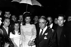 Jackie O holds onto her daughter, Caroline Kennedy, as the newlywed couple boards Aristotle Onassis's yacht for the reception.