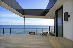 """In trying to conceive some sort of trellis or shade structure for the top-floor deck, W+D realized it had an opportunity. """"Everyone responds to the ocean for obvious reasons, but we felt opportunity to embrace the sky,"""" Woods said, adding that a new architectural element — a roof with a hole punched through the center, like a giant picture frame — draws the eye up and prompts people to appreciate the simply beauty of a blue sky. """"That turned out to be one of our favorite moments in t"""