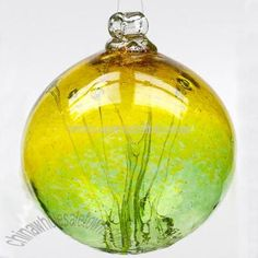 Witch Balls were very popular in the century, but their actual origin is thought to be much older. For well over 300 years, hollow glass spheres have been hung in windows to ward off witch spells Pumpkin Ornament, Hag Stones, Glass Floats, Ball Ornaments, Glass Ball, Book Of Shadows, Crystal Ball, Mosaic Glass, Stained Glass