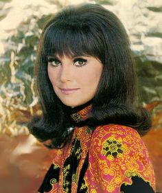 60's hairstyle.  I had this hairstyle, and that is my hair color.  I was even once told that I looked like Marlo Thomas!  What a compliment.  How I wish I looked like her now!