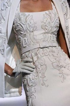 White embroidered jacket and dress, white leather gloves