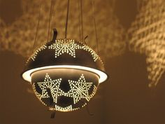 Made from kitchen colanders! Check out the light show it creates at nighttime.