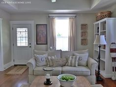 Love living room layout, but room needs more colors, texture, or subtle contrast even if only use neutral colors. Would add low and elegant bench/mudroom console behind sofa to make guests feel welcome. Put 2 matching lamps on console for quiet evenings.