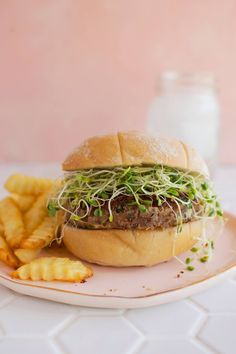 If you are going meatless, then you gotta try this burger out! The patty is made with red beans and rice, and it's topped with sprouts, and places on a yummy toasted bun. Goat Cheese Recipes, Veggie Recipes, Lunch Recipes, Hamburger Vegetarien, Love Food, A Food, Vege Burgers, Pea Protein Powder, How To Make Meatballs
