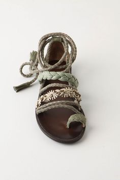 earthy you could replace straps on an old pair of sandals with scraps of fabric and lace
