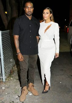 Kim Kardashian wears a sexy white dress while attending the DuJour Art Basel party in Miami Beach with fiance Kanye West.